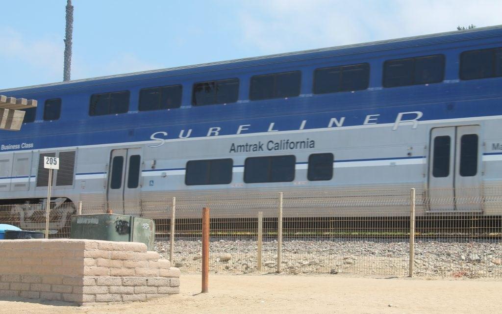 Surfliner, Amtrak California along T-Street beach in San Clemente, CA