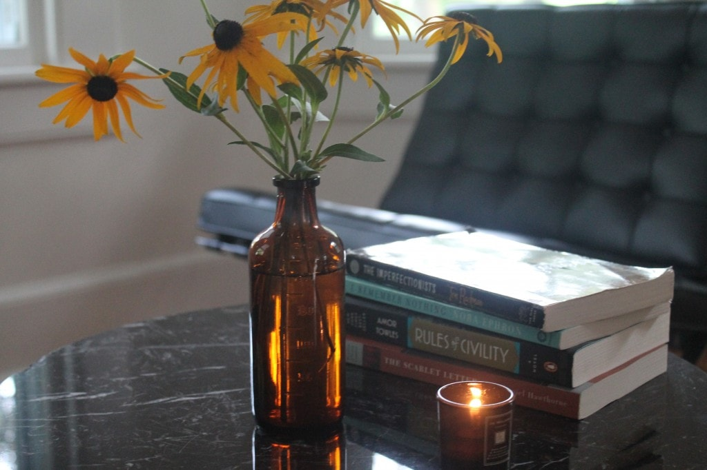 Black eyed susans and our latest stack of books.