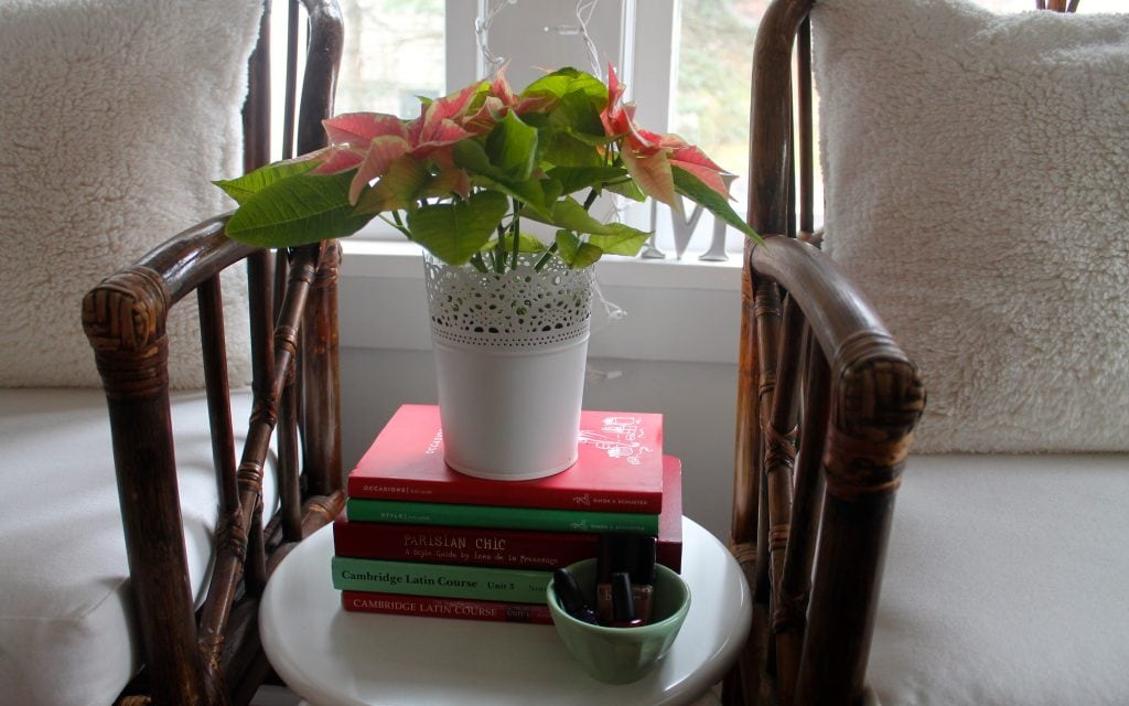 red and green Kate Spade books and a poinsettia