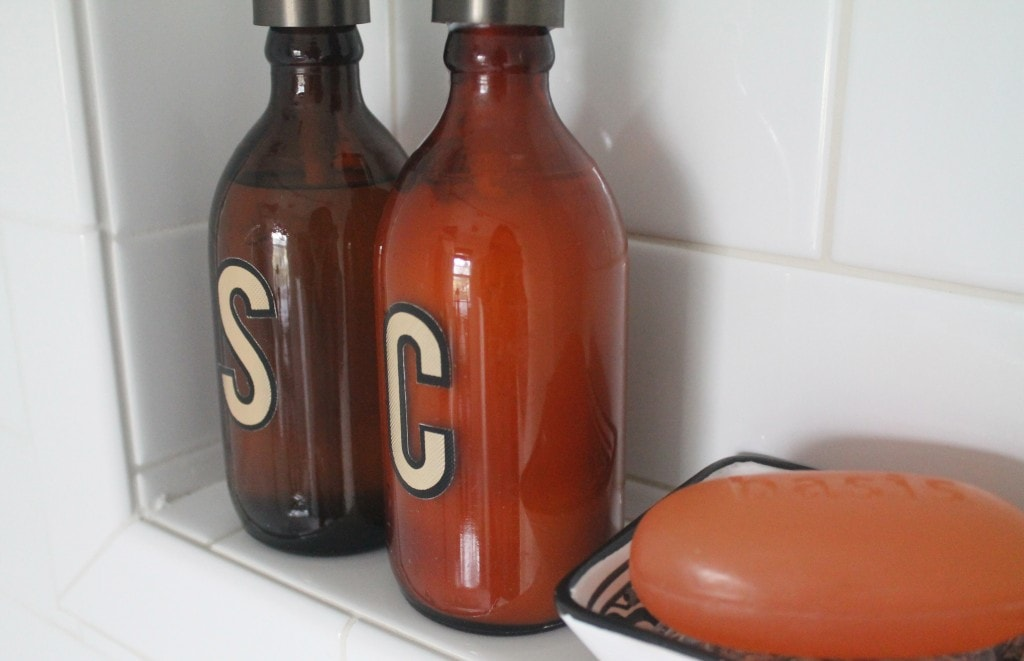 amber bottles repurposed for shampoo and conditioner with mailbox letters