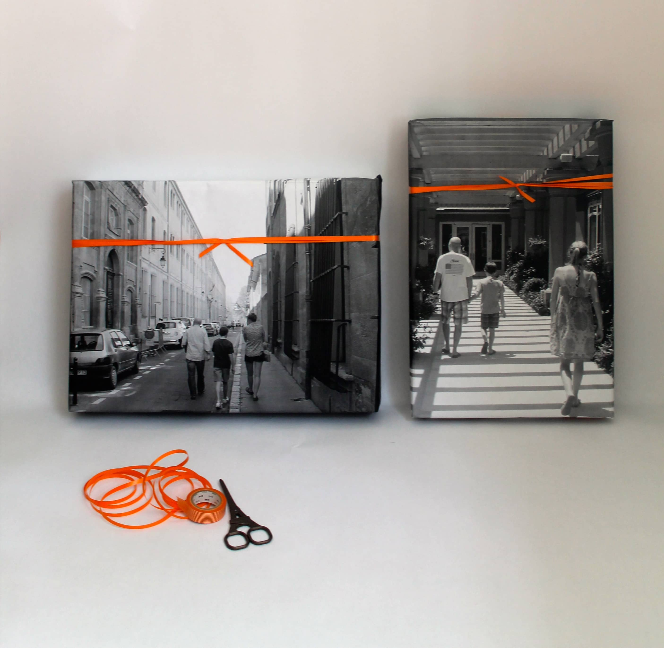 gifts wrapped using photos and orange ribbon