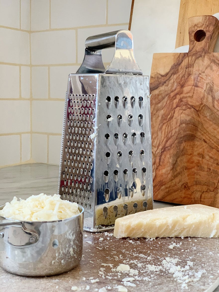 cheese, cheese grater, cutting board