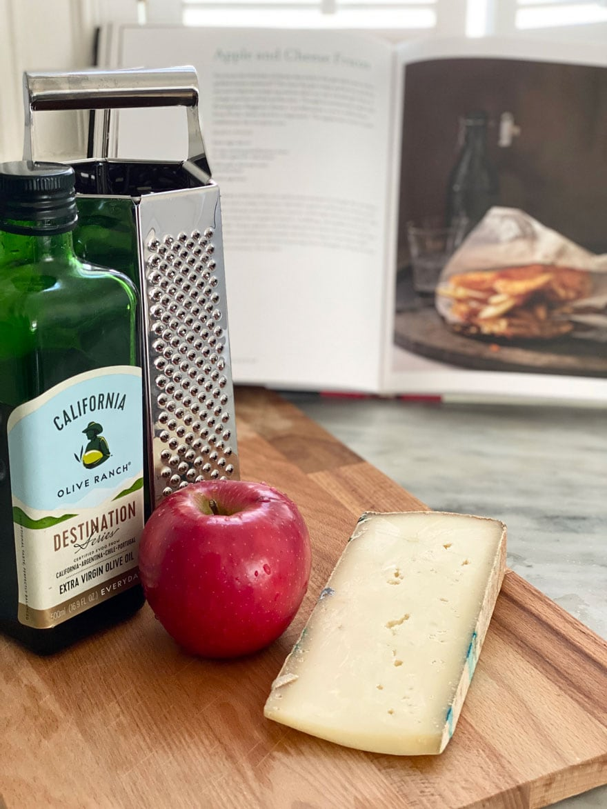 olive oil, apple, cheese, grater, cookbook