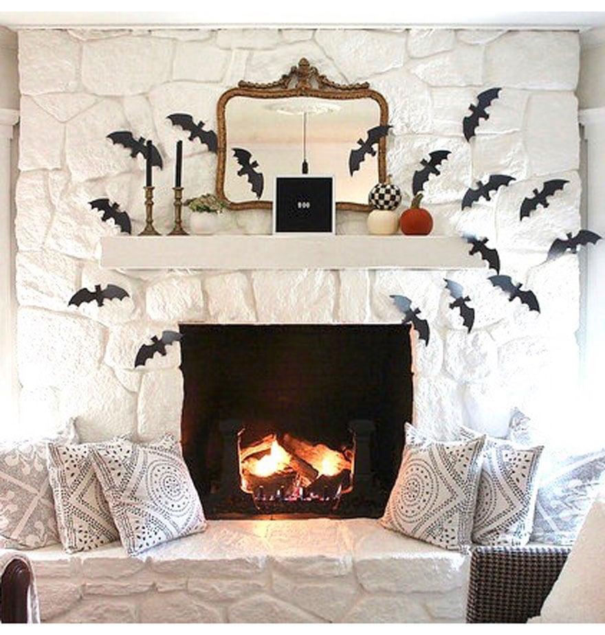 White Fireplace With Bat Cutouts