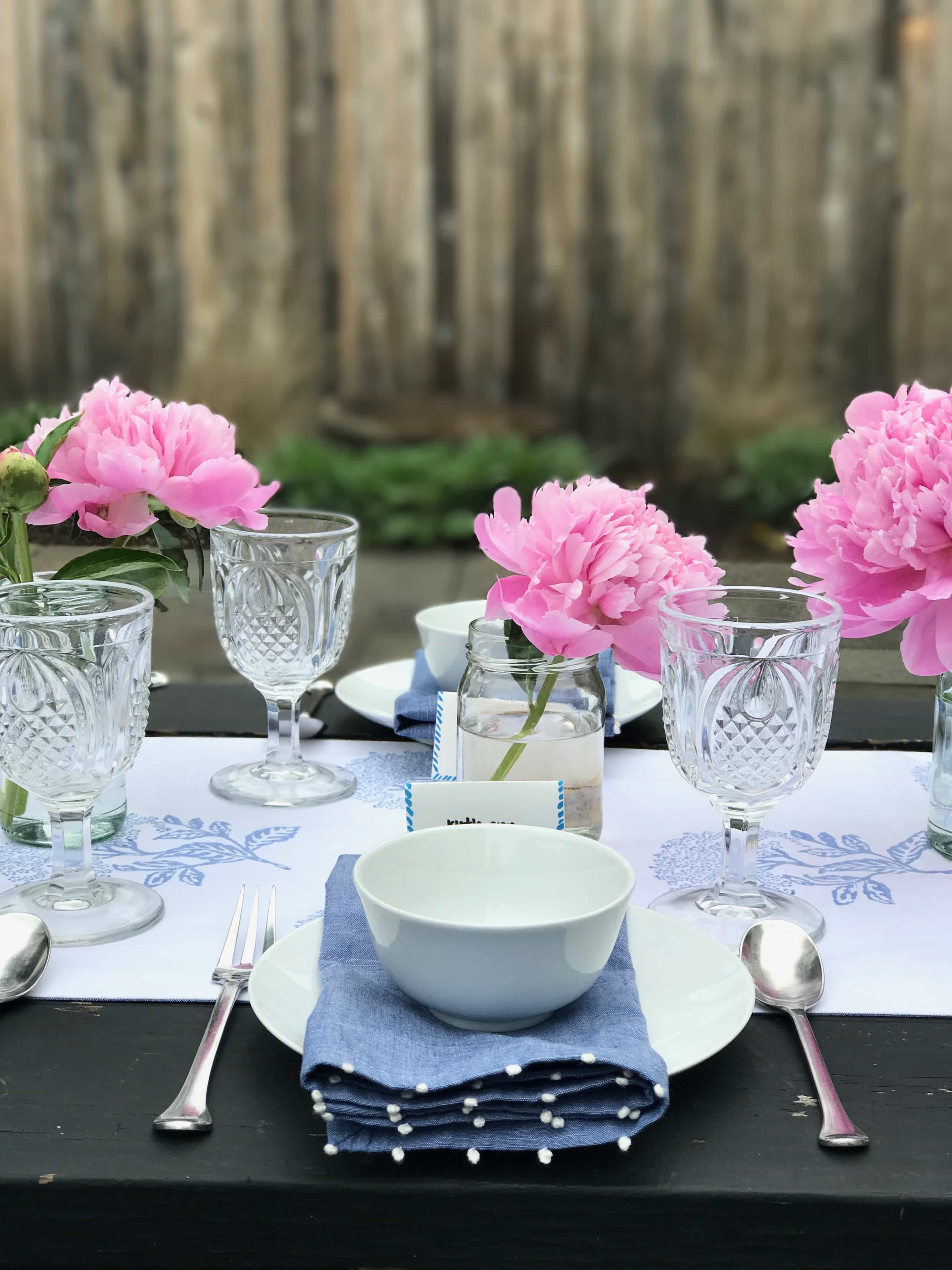Tablescape for Spring with pink peonies and blue & white linens from Serena & Lily