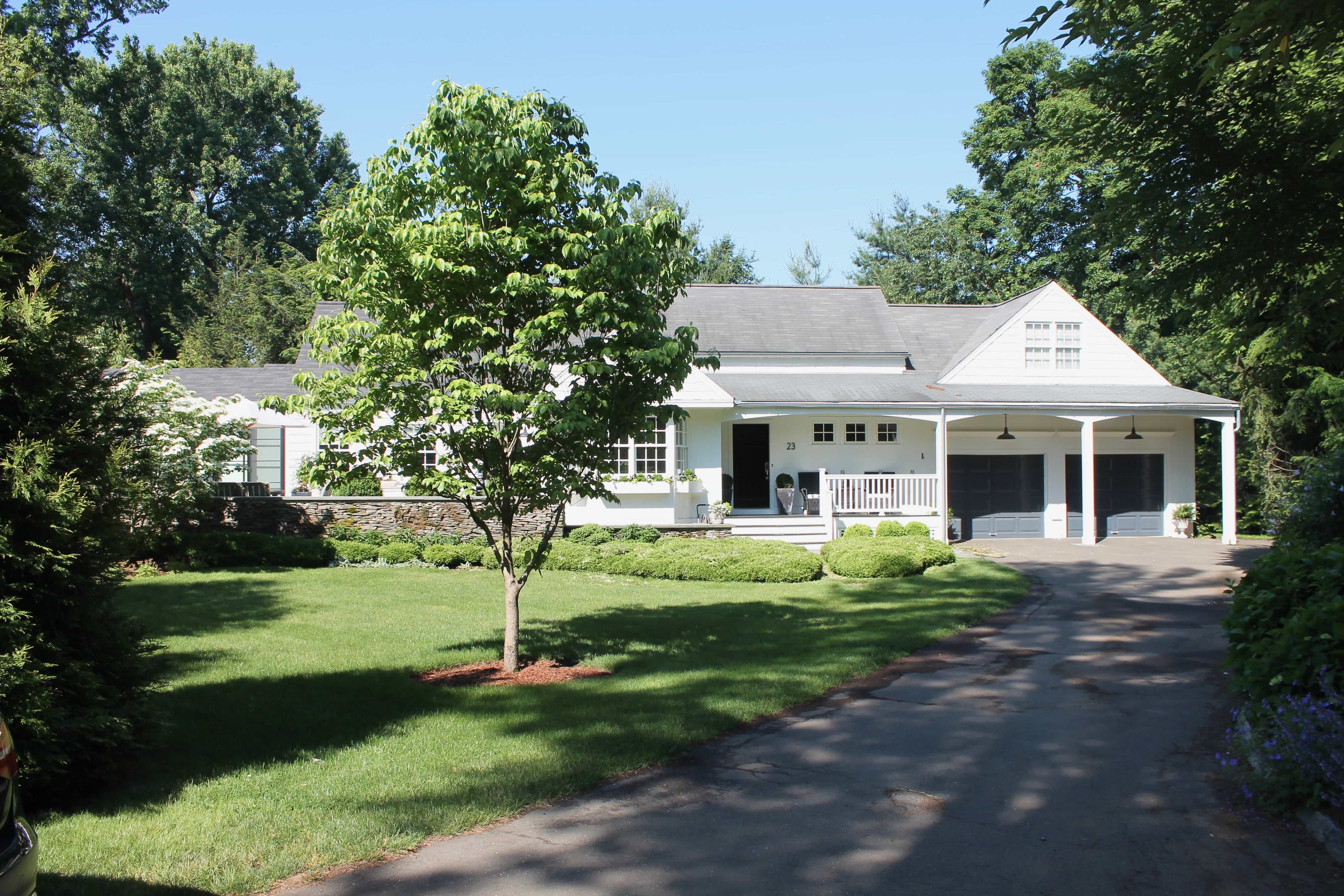 A Connecticut Cottage Style house in black and white
