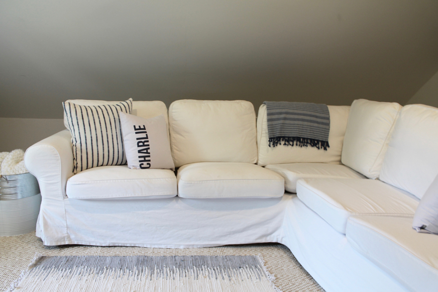 Cozy attic playroom white sectional