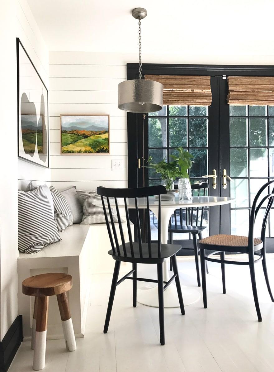 Fresh kitchen nook banquette saarinen table tulip table shiplap