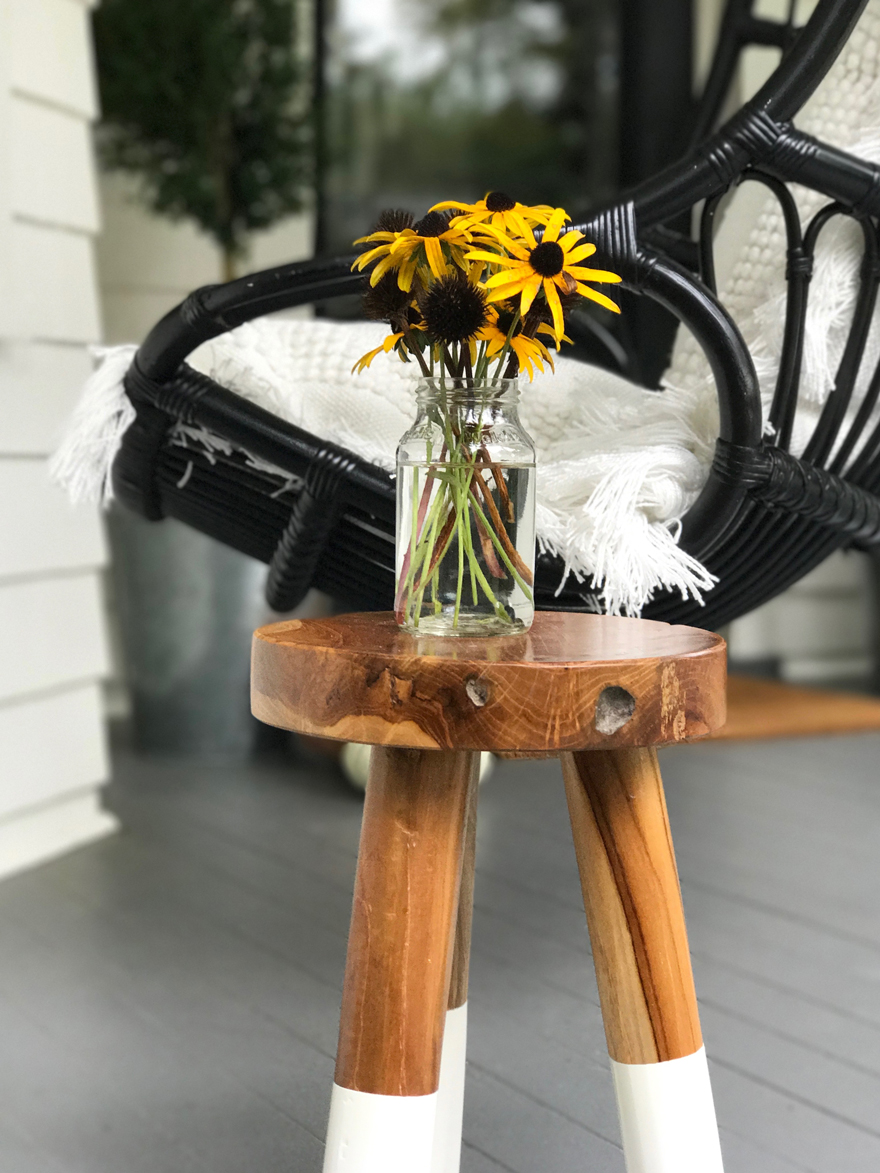 Black-eyed-Susans-fall-garden-flowers-repurposed-jars-bohemian-style-hanging-chair-porch-fall