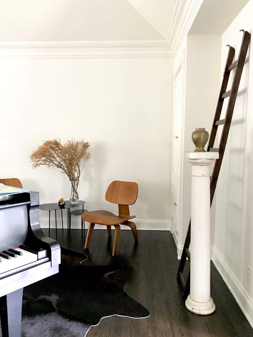 Music-Room-Piano-Ladder-Art-Column-Display-Eames-Chairs-hide-rug