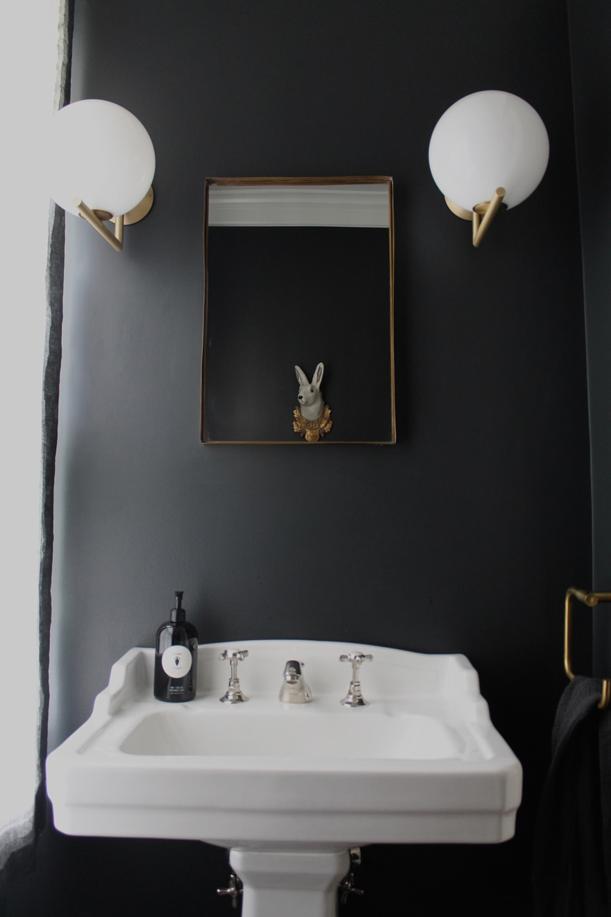 Pitch-Black-Farrow-and-Ball-Paint-Powder-Room-Modern-sconces-gold-accents-brass