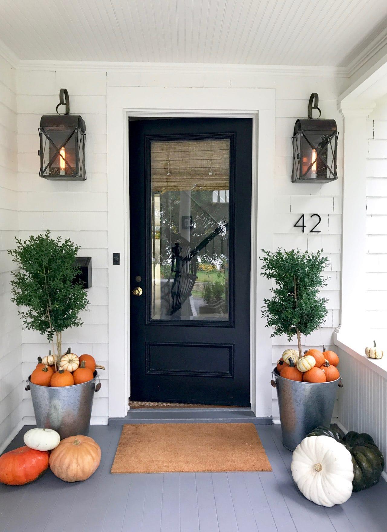 Pumpkins-galvanized-pots-front-porch-Halloween-white-cottage