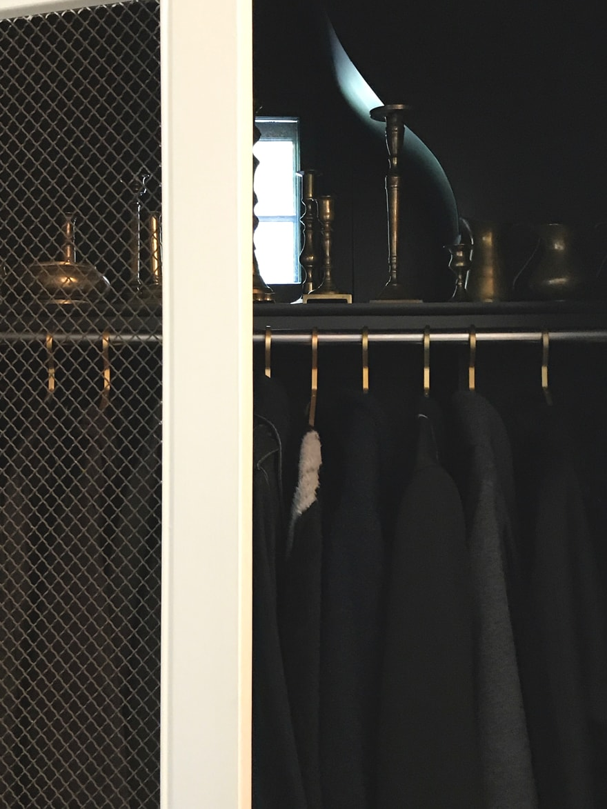coat-closet-wire-mesh-cabinet-doors-brass-collection-black-paint-brass-hangers