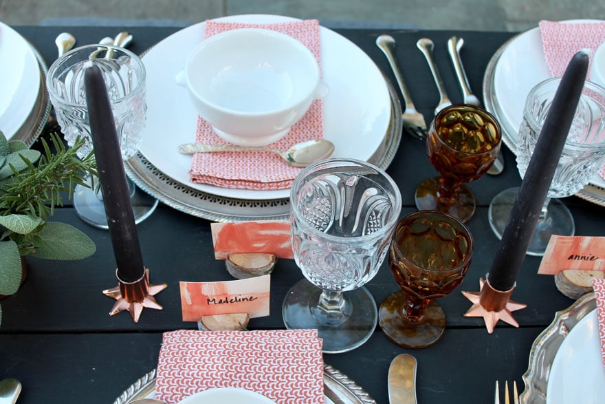 black-picnic-table-copper-candles-alfresco-tablescape