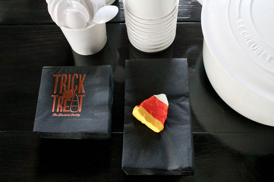 Find a triangle shaped rock and paint like candy corn for weight to use on a stack of napkins.