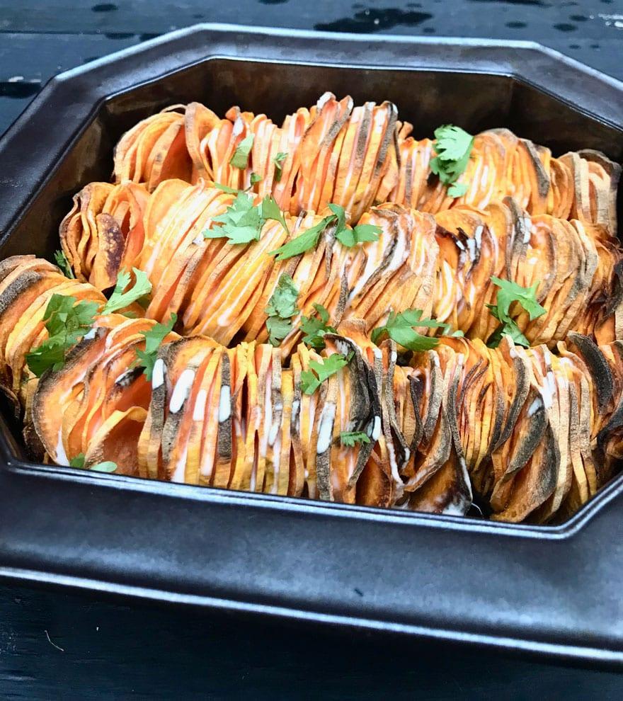 crispy sweet potato roast with sriracha cream sauce