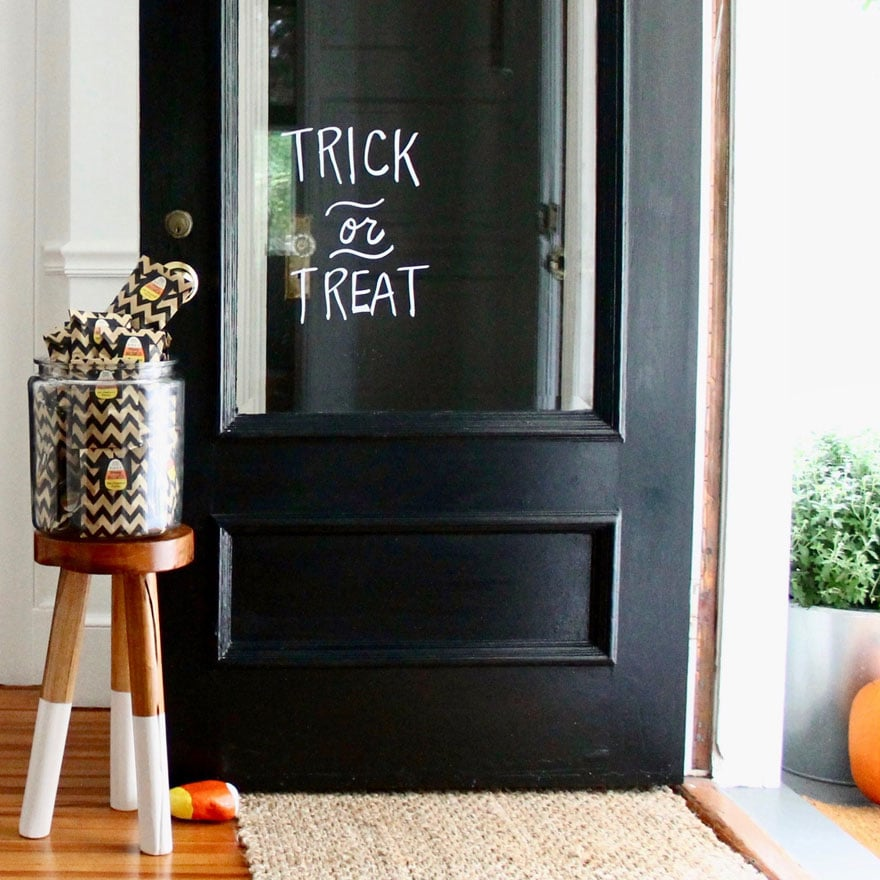 Use a Sharpie to write Trick~or~Treat on your glass door