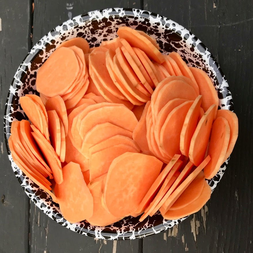 A bowl of sliced sweet potatoes