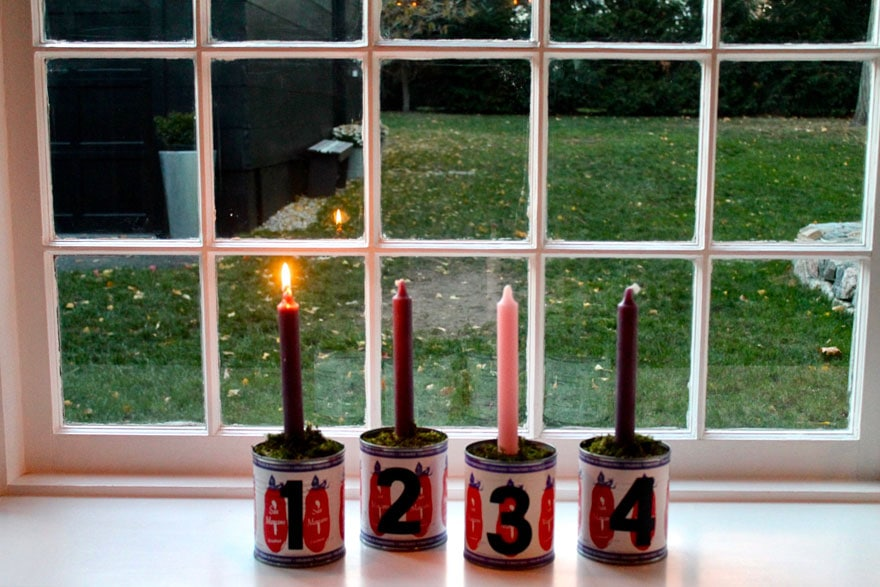 a diy advent candle display using San Marzano tomato cans