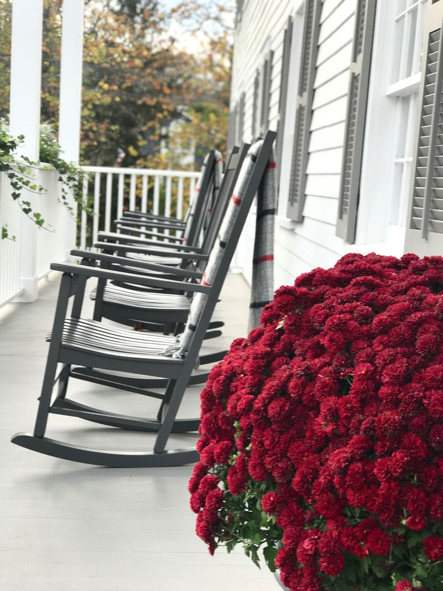 GrayBarns dreamy front porch with rocking chairs and wool blankets in the fall
