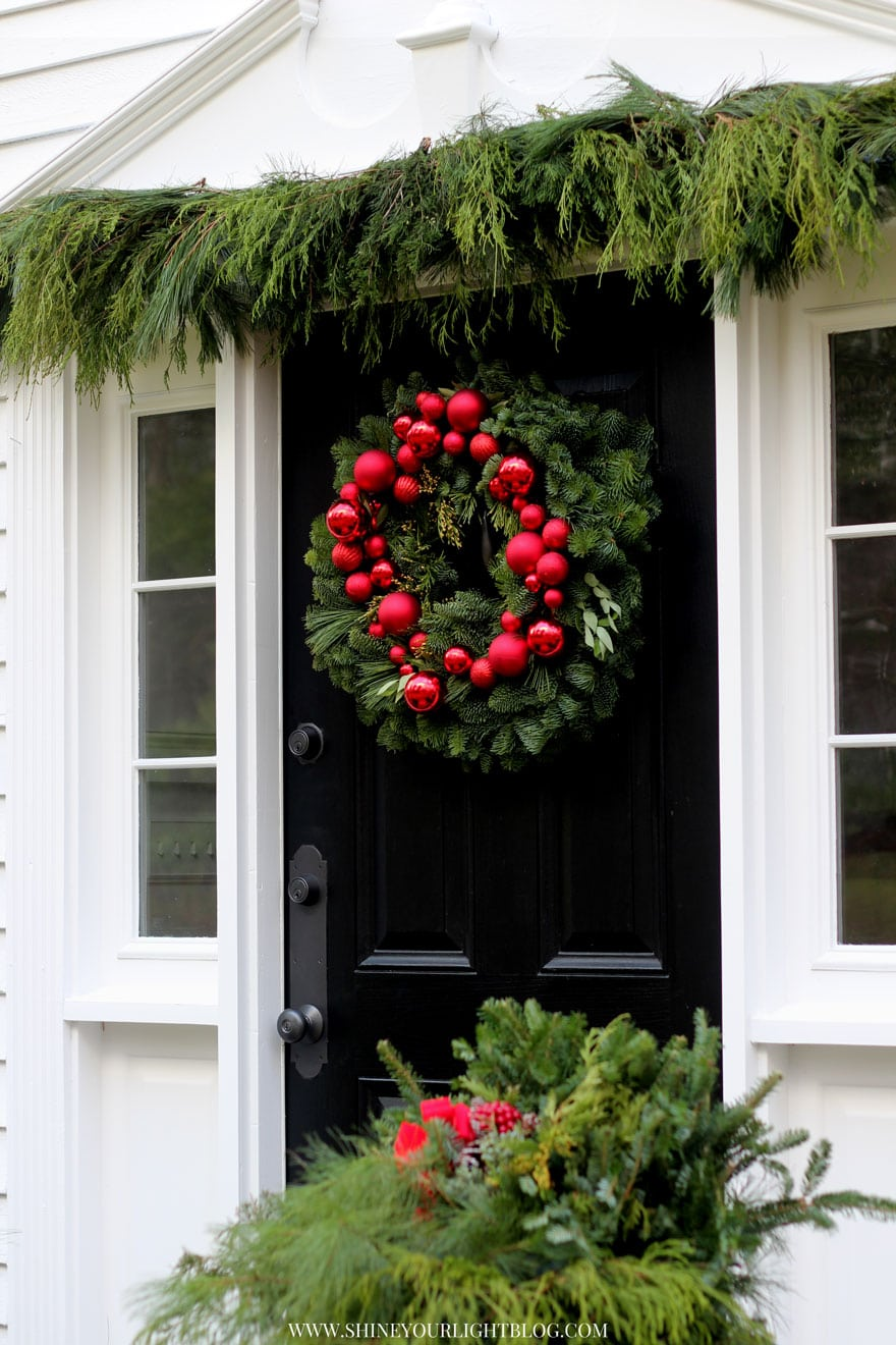 Love this traditional New England front door all decked out for the holidays