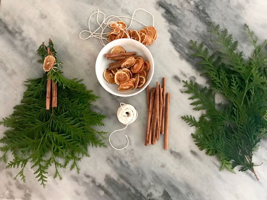 Easy to make swags from Arborvitae evergreens, cinnamon sticks and dried orange slices.