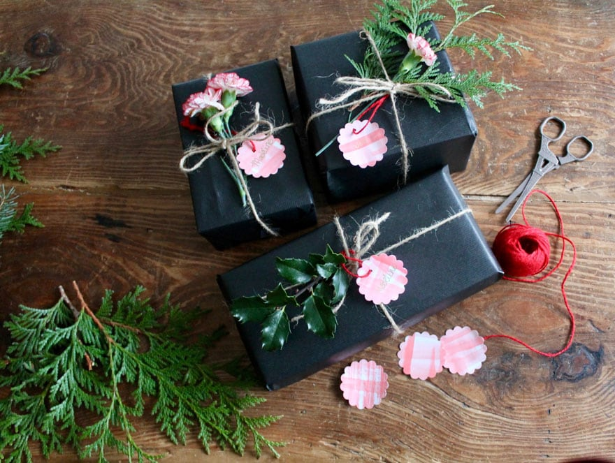 Add a watercolor diy gift tag with black paper and fresh greenery or a flower