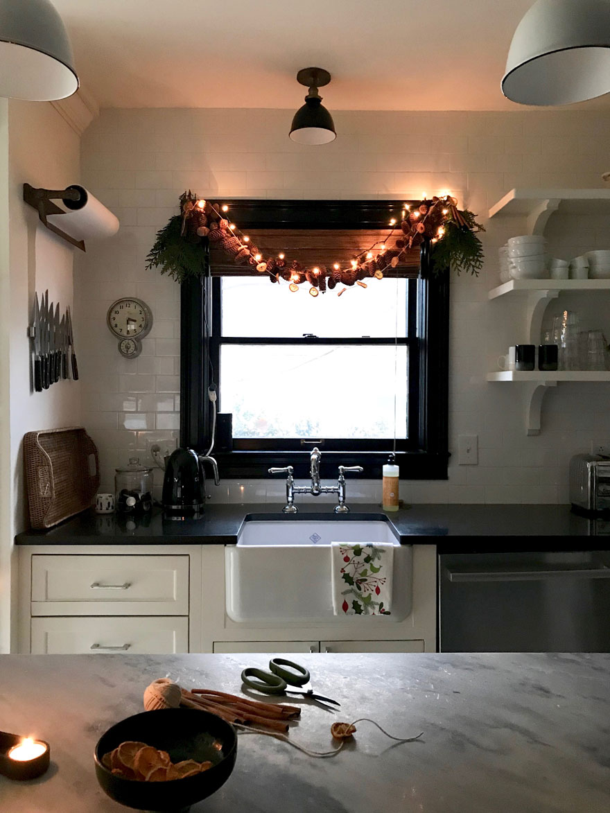 A little kitchen Christmas garland over the kitchen window makes it cozy for the holidays