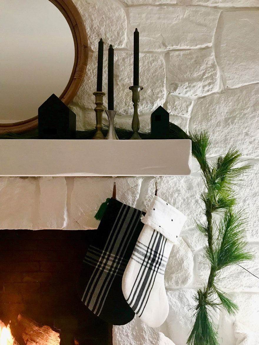 We painted our stone fireplace with Chalk Paint by Annie Sloan just in time for the holidays.