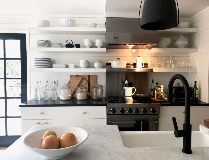open shelving, Viking Stove, white marble, bowl of fruit