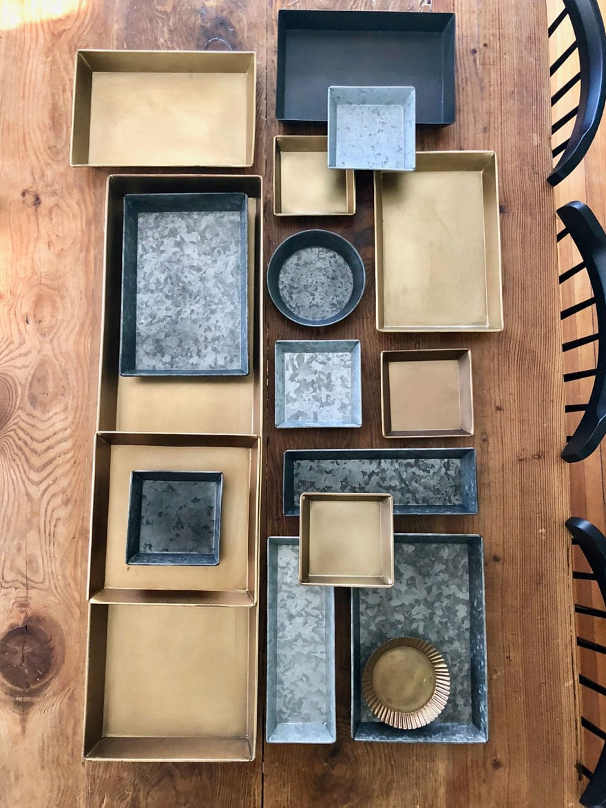 brass, zinc trays on table top