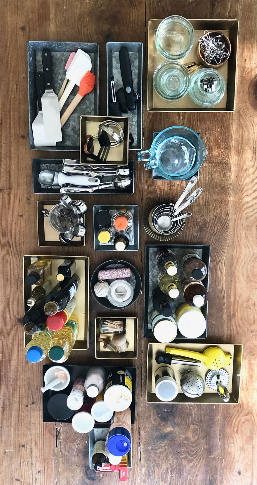 kitchen tools and products organized in trays