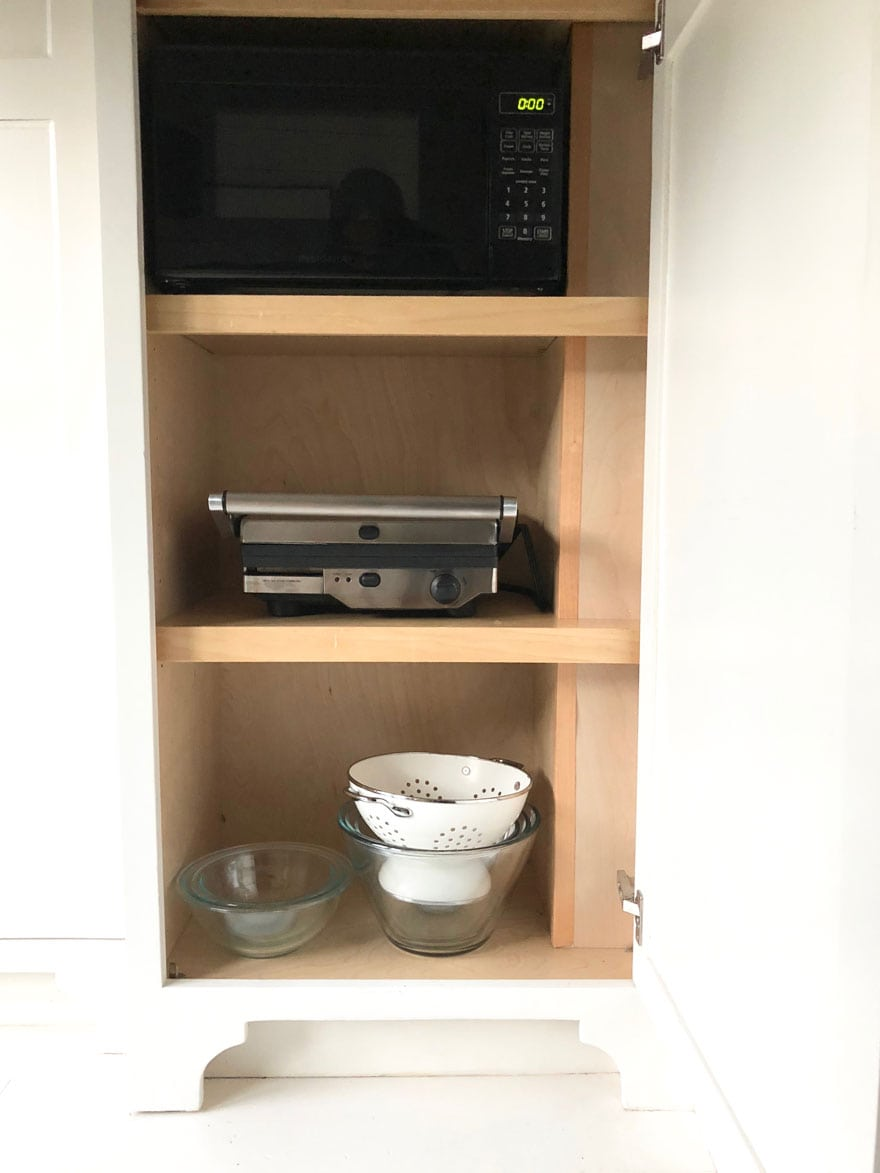 microwave oven in kitchen cabinet