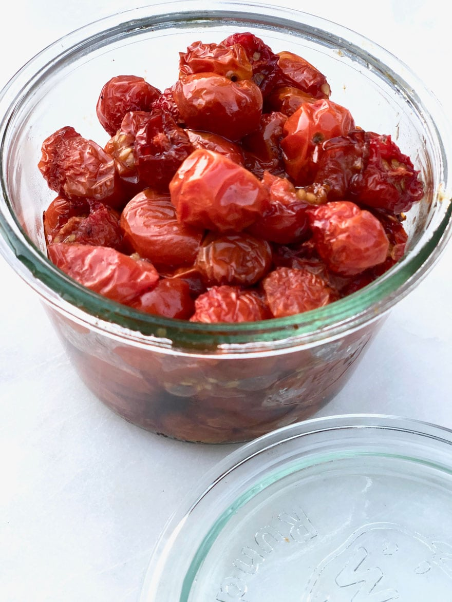 roasted cherry tomatoes in glass jar