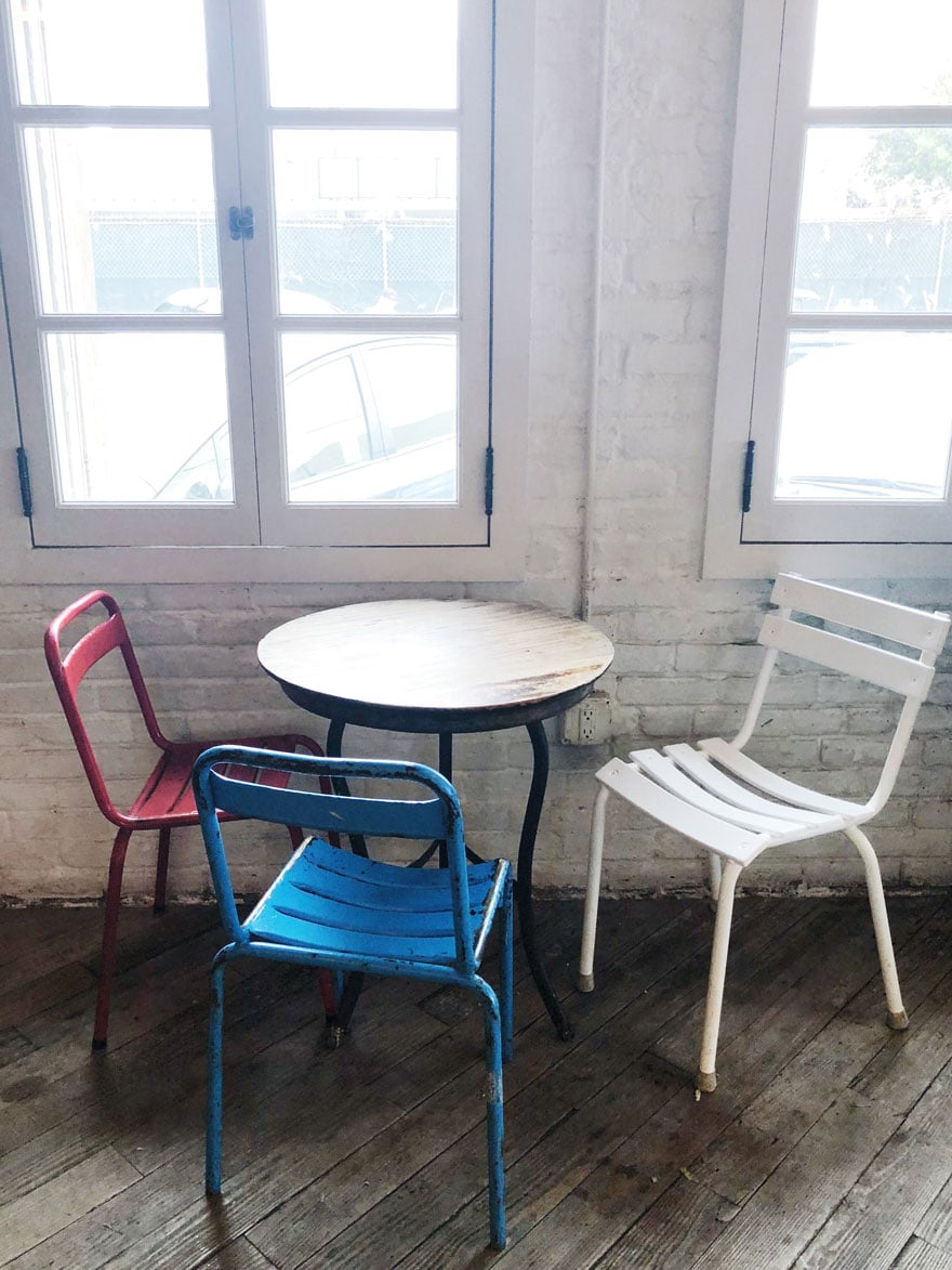 cafe table with three chairs