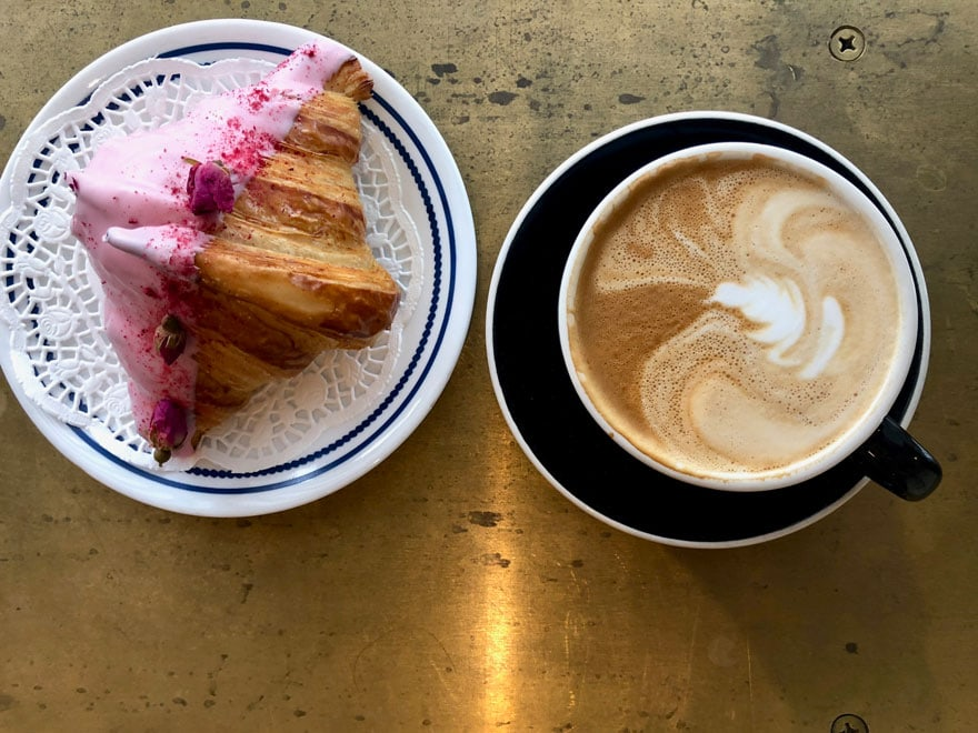 pink croissant and cappuccino