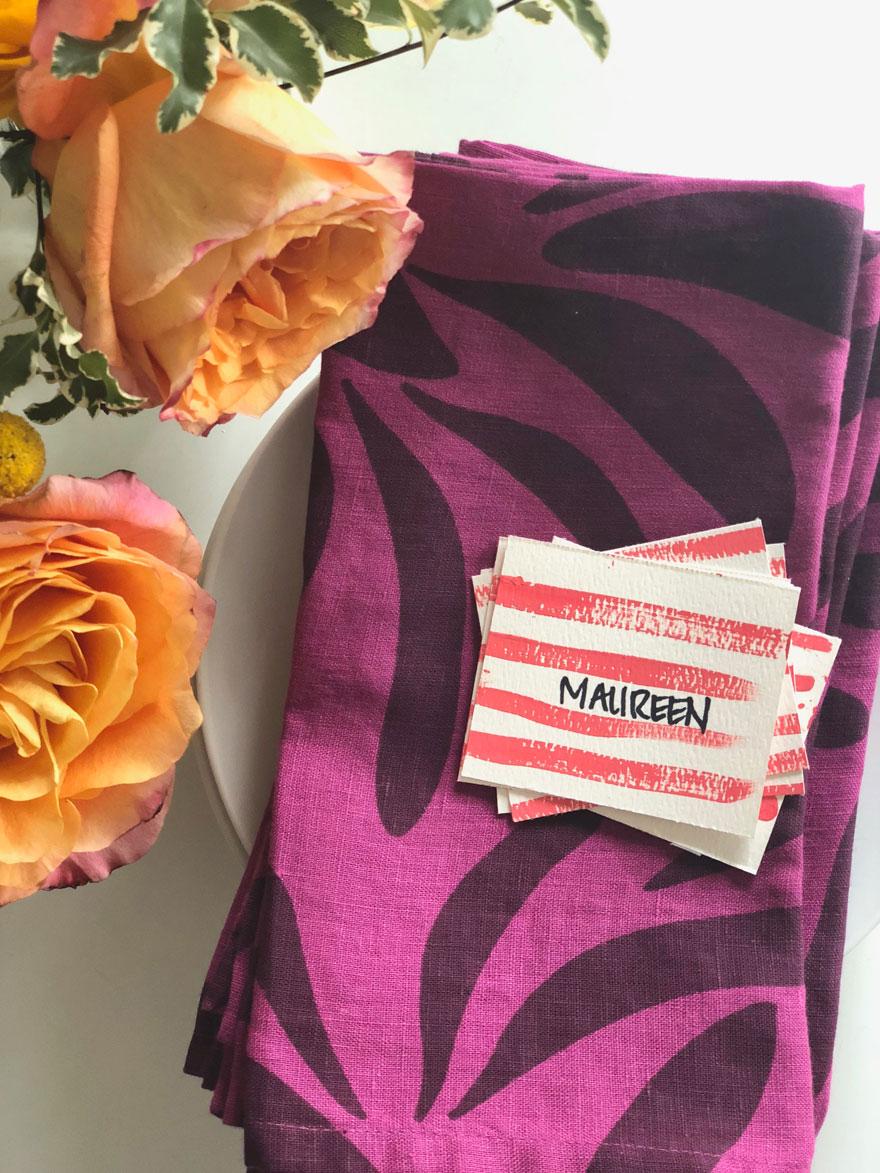 napkin, placecard, rose