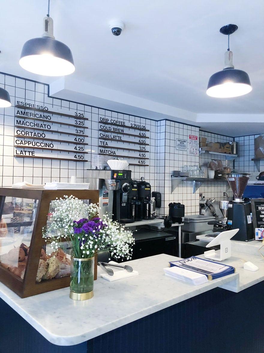 menu on tile backsplash, coffee shop counter