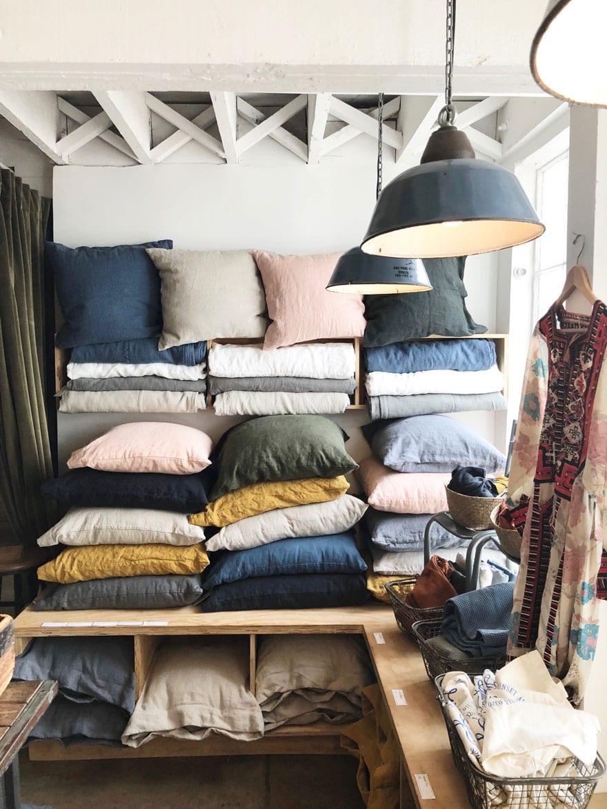 stacks of linen pillows