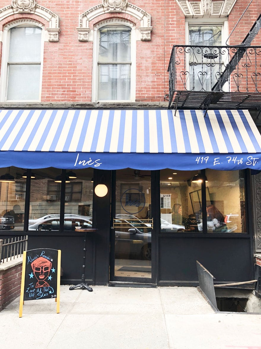cafe with striped awning NYC