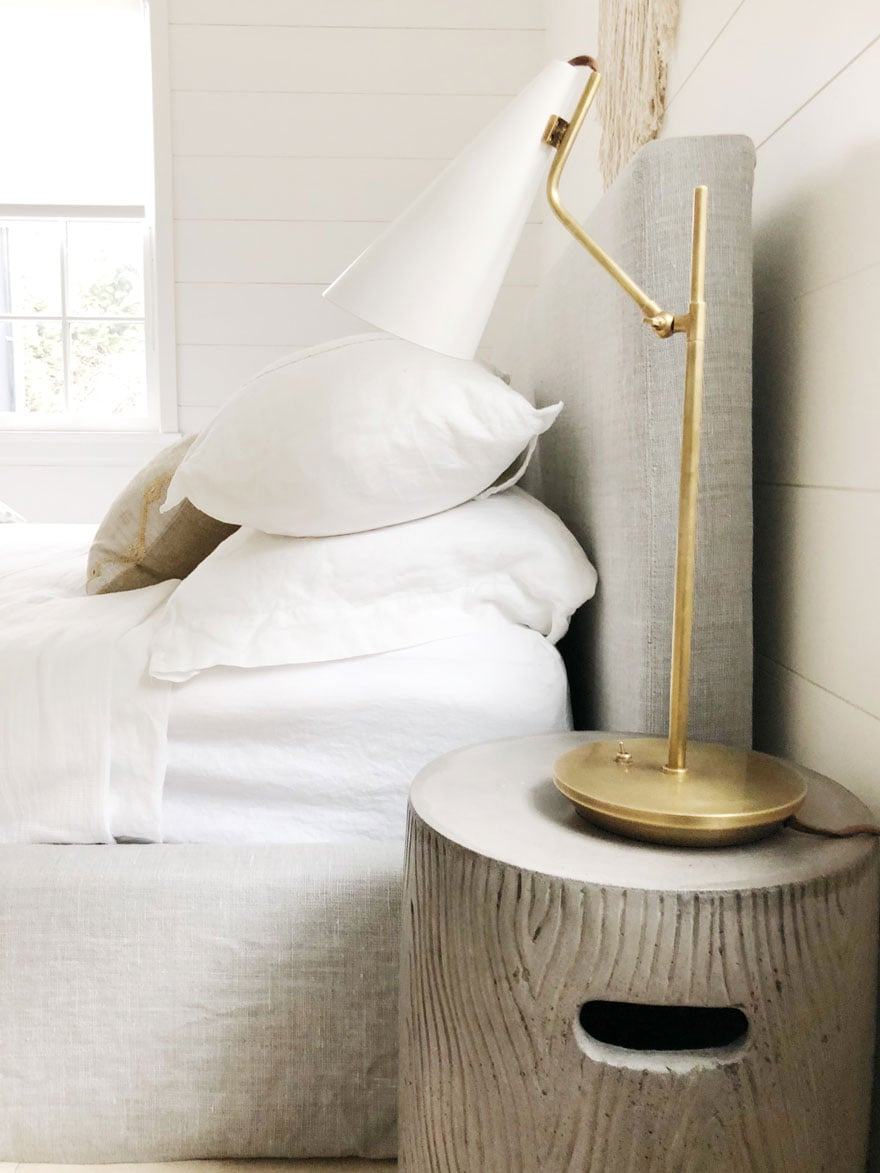 table lamp, round side table, bed
