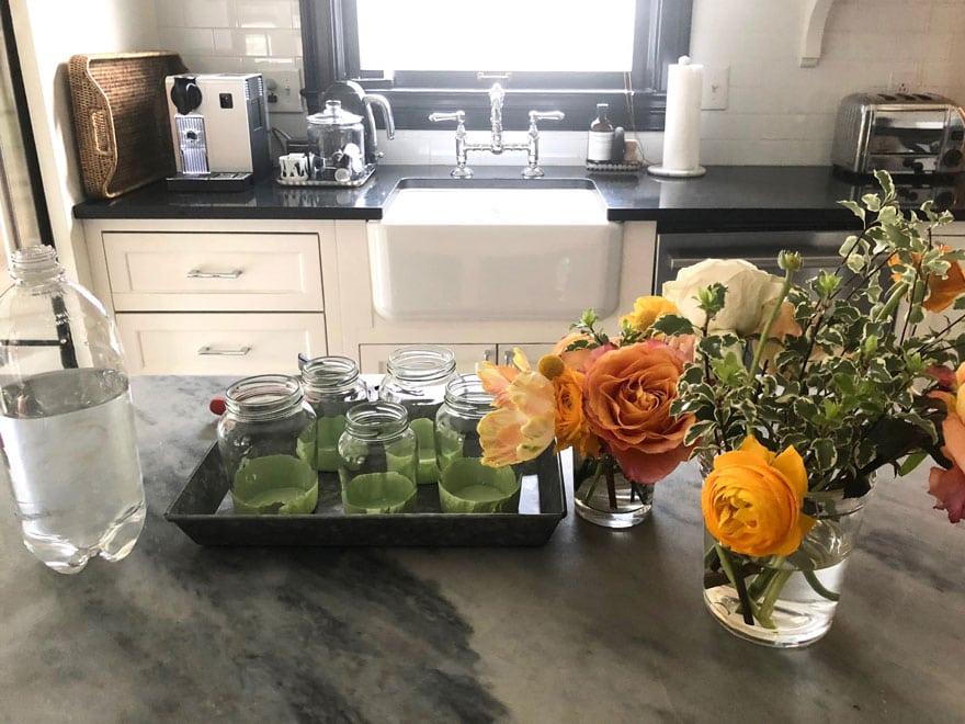 jars, flowers on marble top