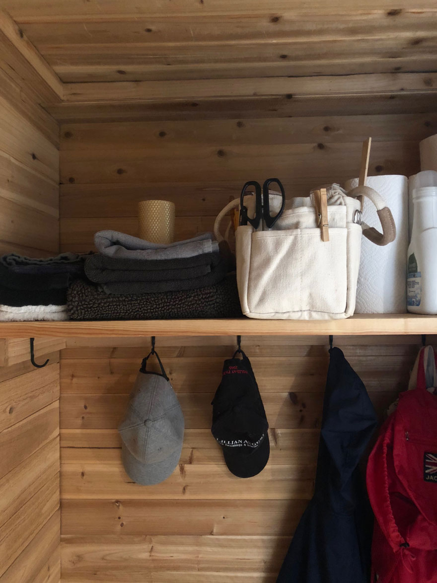 shelf, household supplies, hats on hooks