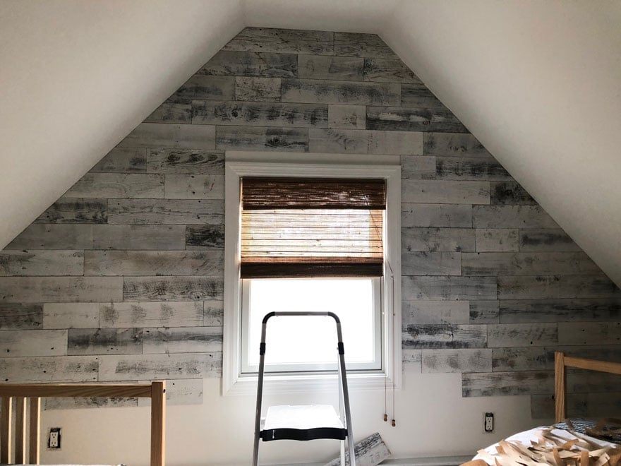 reclaimed wood on attic wall with window