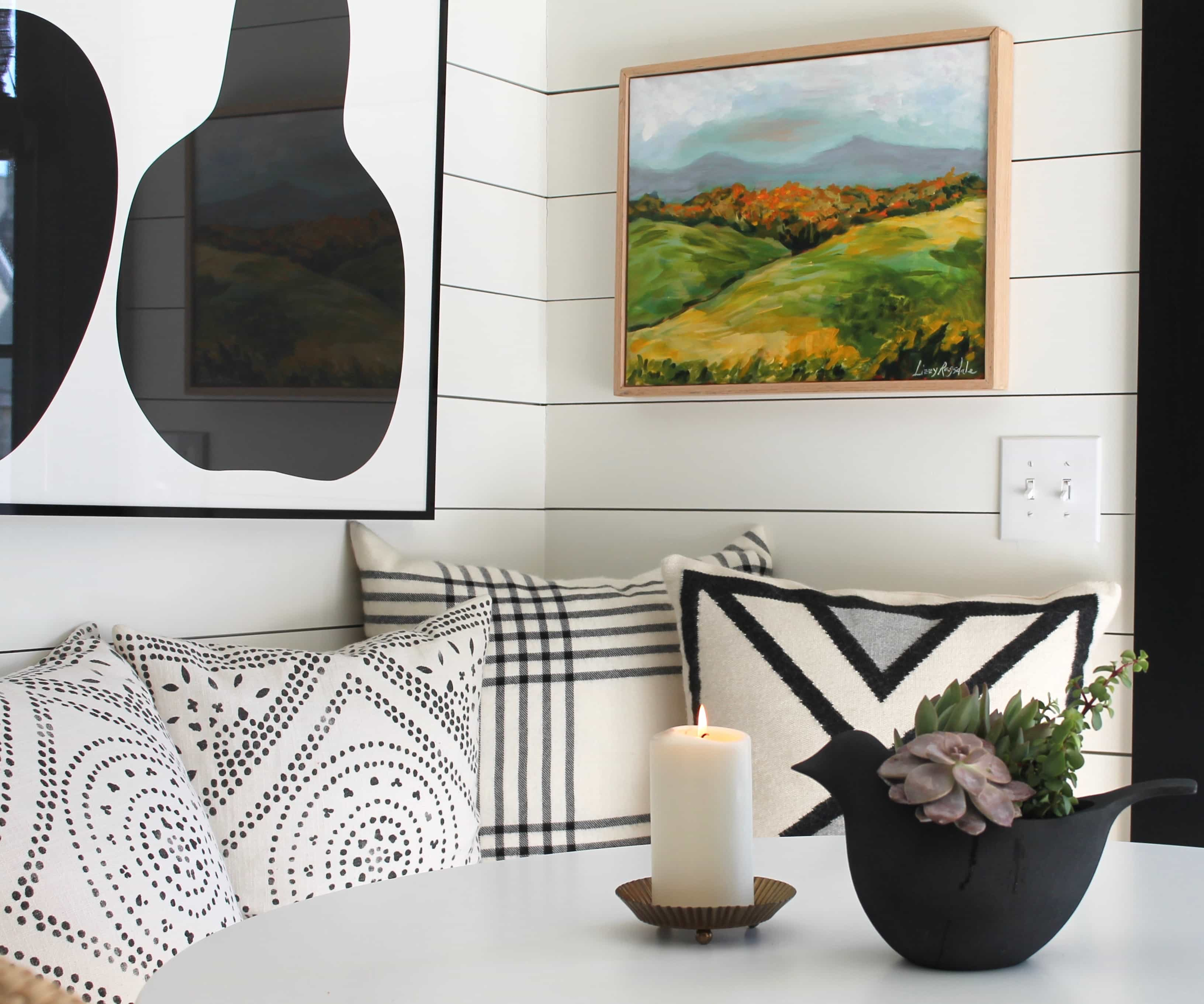 pillows, art, tabletop with planter