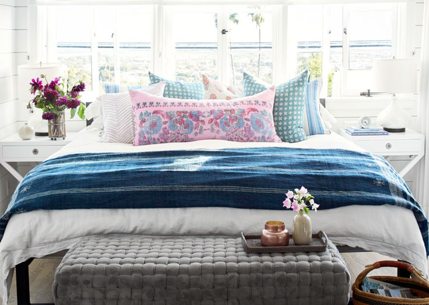 bed with pillows, bench