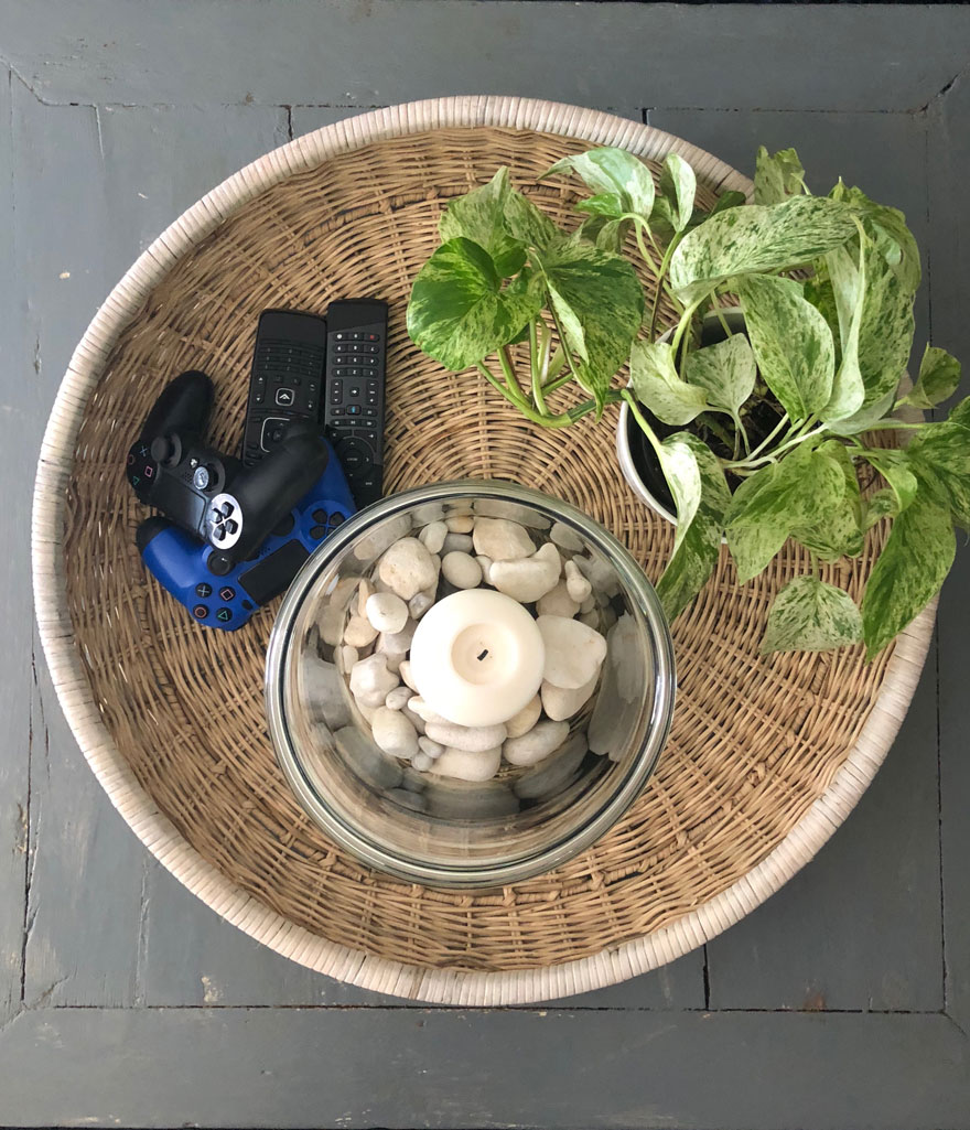 round tray with plant and candle on table
