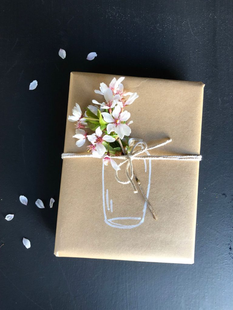 a gift with a flower on it