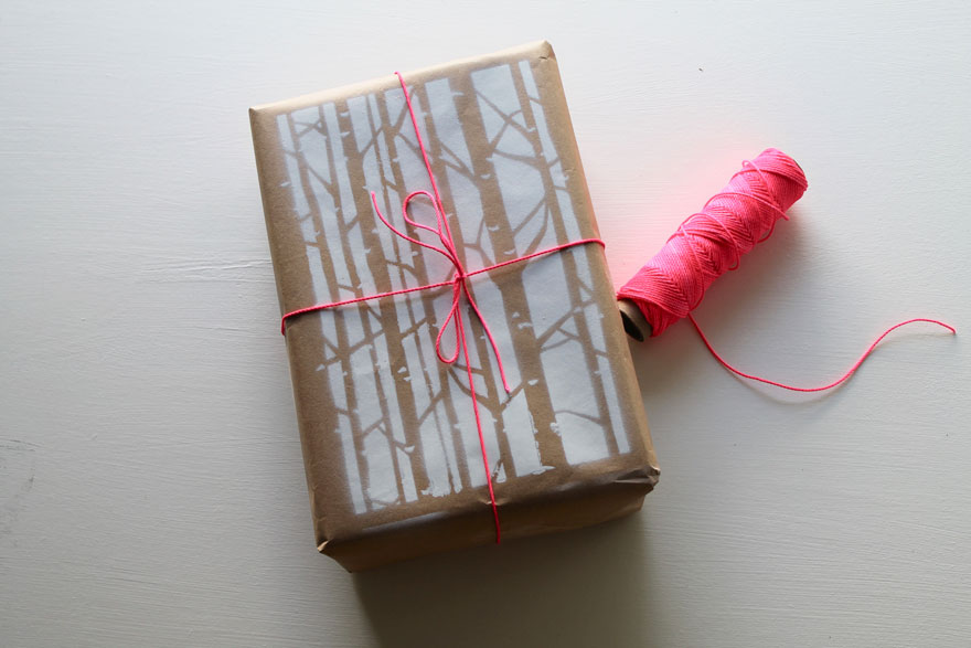gift wrapped in kraft paper with stencil and twine