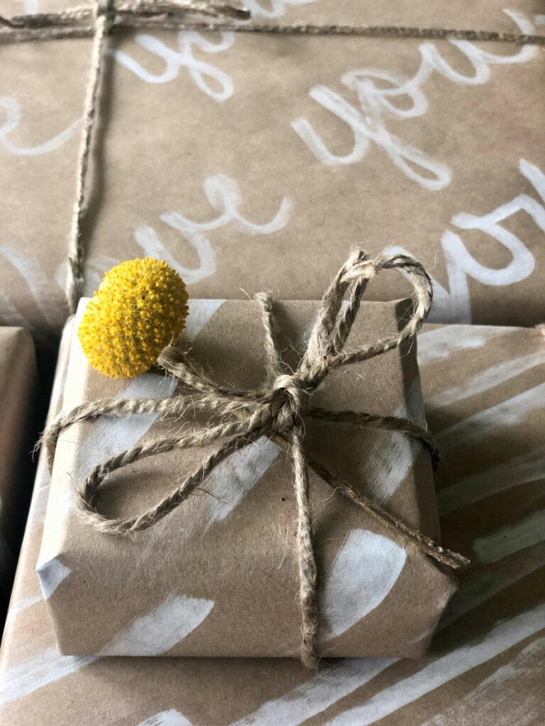 package with billy ball flower and twine